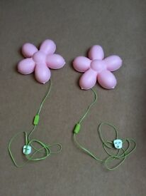 Two pink flower wall lights. With fixings. A green cable as a stem with on/off switch.