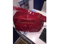 Koto red changing bag