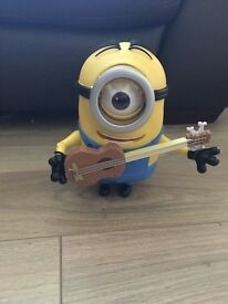 Talking and singing minion with guitar in excellent working condition