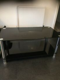 Black glass coffee table in decent condition