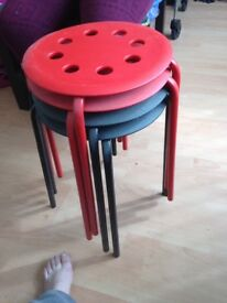 2 red and 2 black small stools