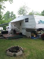 Smoke Free Fifth Wheel with deck, site, kayak and LOTS more.