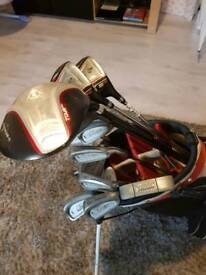 Set of golf clubs and balls and bag