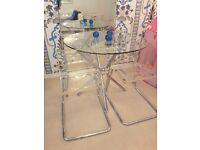Glass Topped Dining Table & 4 plexi-glass matching chairs