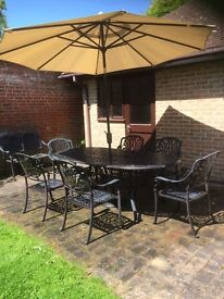 Garden table, chairs, umbrella and love seat