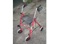 Walking aid with seat and brakes