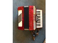 Galotta Accordian, red, German made, excellent condition with hard case