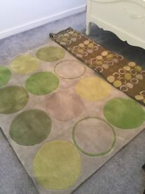 Beautiful green and brown curtains and matching rug from smoke and pet free home