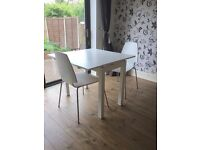 Ikea Bjursta white extendable dining table & 2 white Vilmar chairs - great for small rooms!