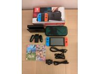 Nintendo Switch boxed like new + 2 Games and SD card