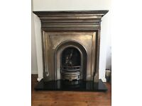 Coal effect gas fire with cast iron surround and marble hearth
