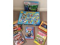 Selection of puzzles, books and dvds including Thomas and fireman sam