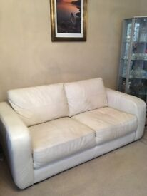 Leather suite in good condition. Two seater with chair in cream, fire rated