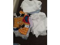 Mix of babygrows and vests all different