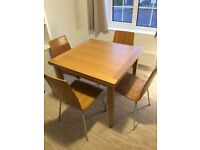 4-6 seat extending solid oak dining table and 4 oak chairs from John Lewis