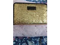 Small glittery purse with few pockets