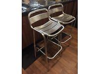 2 metal bar stools.