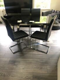 Luxury glass dining table and chairs.As new! Great bargain!
