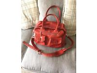Lin and Leo baby change bag red leather