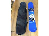 Snowboard (Salomon) with Ride bindings and travel bag