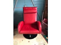 Red leather swivel arm chair with additional head rest