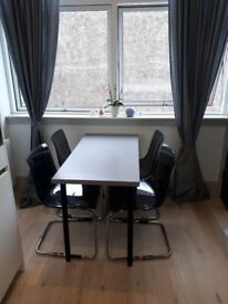 Good as new small kitchen table. Grey/Black and very modern. Originally from IKEA