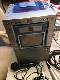 Karaoke machine and cds , and mics -Xmas parties, New Year's Eve etc !!!