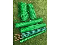 green mesh safety fence with sturdy steel stakes
