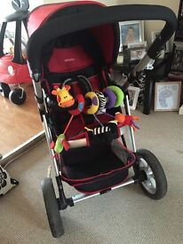 Red pushchair for sale. Suitable from birth. In excellent condition.