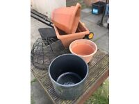 Various garden pots and wall baskets