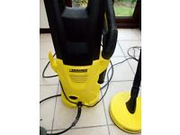 Karcher K2 power washer with attachments 2 x nozzles and floor cleaner slight leak but works