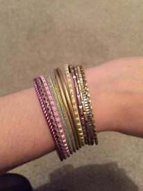 Pink and gold bangles