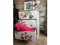 Chest of drawers with floral detail