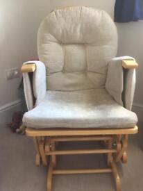Nursery glider/rocker chair with matching footstool.