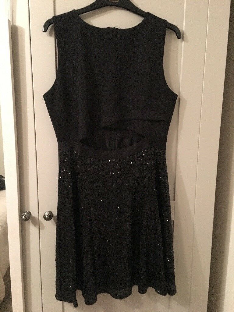 Black dress with sequin skirt