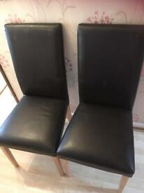 Two faux leather brown chairs