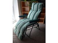 Green striped gardening chair / sun lounger with cushion