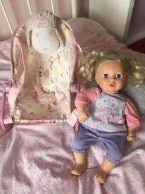 Baby Annabelle doll with bouncer
