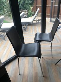 Paid of brown leather dining chairs
