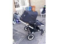 Bugaboo Donkey Duo. Chrome chassis with black fittings.
