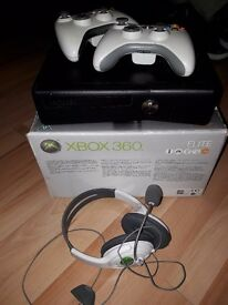 Xbox 360 with two controllers and 16 games