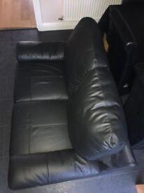 2 seater leather look black sofa