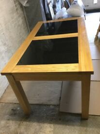 Dining Table wood and black granite,extendable.good condition