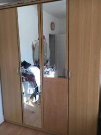 oak coloured 4 door wardrobe