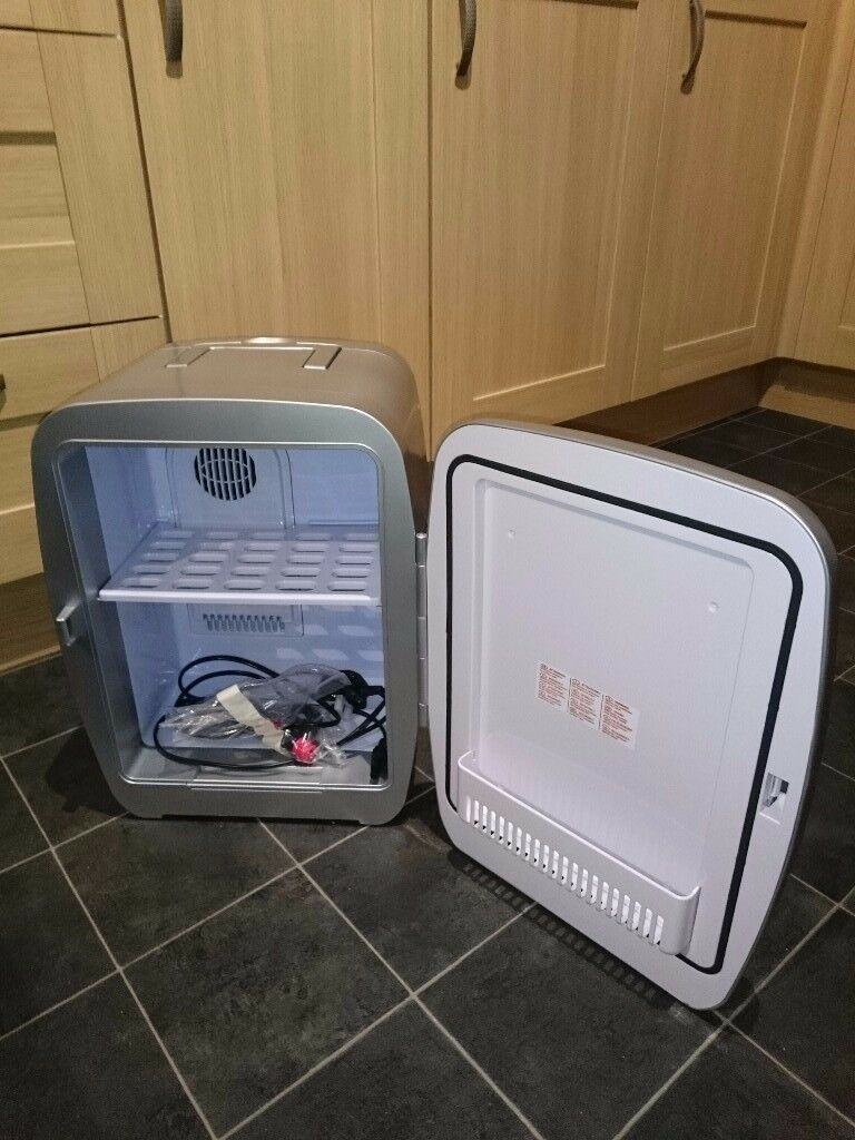 Silver mini retro fridge excellent condition with original packaging and box