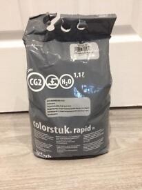 Bag of porcelanosa grout - grey