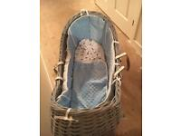 Baby boys blue wicker Moses basket