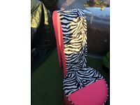 Zebra print and pink shoe chair