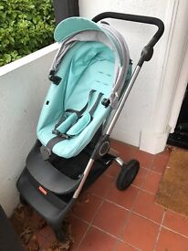 Stokke Scoot new model used twice. Comes with winter cover kit.