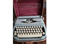 Portable typewriter with case.